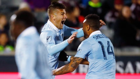 Sporting Kansas City forward Diego Rubio, left, celebrates scoring the tying goal with forward Khiry Shelton during the second half of the team's MLS soccer match against the Colorado Rapids on Saturday, March 24, 2018, in Commerce City, Colo. The teams played to a 2-2 tie. (AP Photo/David Zalubowski)