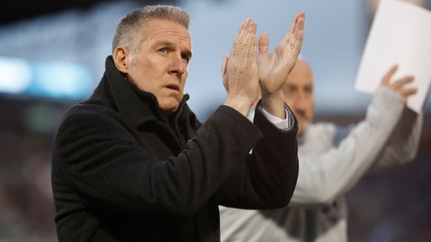 Sporting Kansas City head coach Peter Vermes acknowledges fans as he takes the pitch to lead his team against the Colorado Rapids in the first half of an MLS soccer match Saturday, March 24, 2018, in Commerce City, Colo. (AP Photo/David Zalubowski)