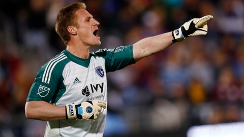 Sporting Kansas City goalkeeper Tim Melia directs his teammates against the Colorado Rapids in the first half of an MLS soccer match Saturday, March 24, 2018, in Commerce City, Colo. (AP Photo/David Zalubowski)