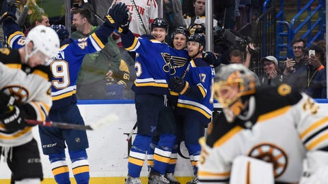 Mar 21, 2018; St. Louis, MO, USA; St. Louis Blues left wing Jaden Schwartz (17) celebrates with teammates after scoring the game winning goal in overtime at Scottrade Center. Mandatory Credit: Joe Puetz-USA TODAY Sports