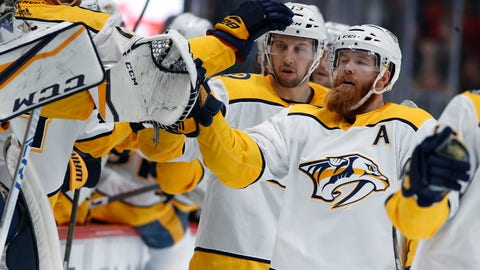 Nashville Predators defenseman Ryan Ellis, right, is congratulated as he passes the team box after scoring the tying goal in the third period of an NHL hockey game against the Colorado Avalanche Sunday, March 4, 2018, in Denver. (AP Photo/David Zalubowski)
