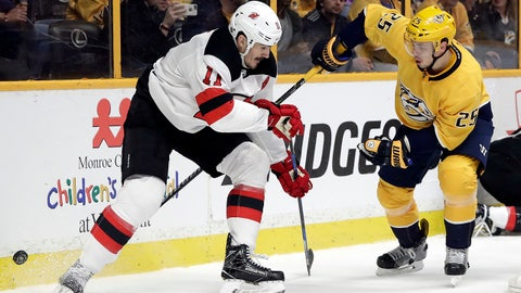 New Jersey Devils center Brian Boyle (11) and Nashville Predators defenseman Alexei Emelin (25), of Russia, battle for the puck in the first period of an NHL hockey game Saturday, March 10, 2018, in Nashville, Tenn. (AP Photo/Mark Humphrey)