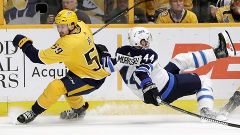 Winnipeg Jets defenseman Josh Morrissey (44) falls as Nashville Predators' Roman Josi (59), of Switzerland, skates past in the first period of an NHL hockey game Tuesday, March 13, 2018, in Nashville, Tenn. (AP Photo/Mark Humphrey)