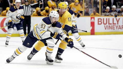 Nashville Predators left wing Scott Hartnell (17) battle for the puck with Buffalo Sabres defenseman Victor Antipin (93), of Kazakhstan, in the second period of an NHL hockey game Saturday, March 31, 2018, in Nashville, Tenn. (AP Photo/Mark Humphrey)