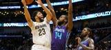 Davis leads Pelicans past Hornets, 119-115