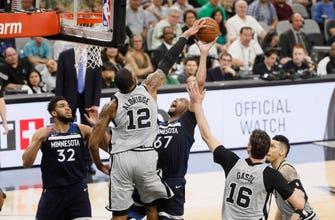 Images of Aldridge's 39 points lead Spurs past Wolves, 117-101