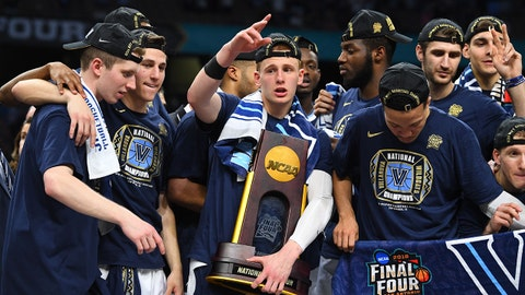 Apr 2, 2018; San Antonio, TX, USA; Villanova Wildcats guard Donte DiVincenzo (10) holds the national championship trophy after defeating the Michigan Wolverines 79-62 in the championship game of the 2018 men's Final Four at Alamodome. Mandatory Credit: Robert Deutsch-USA TODAY Sports