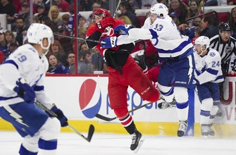 Lightning drop season finale in OT to Hurricanes, await Sunday's results to learn playoff opponent