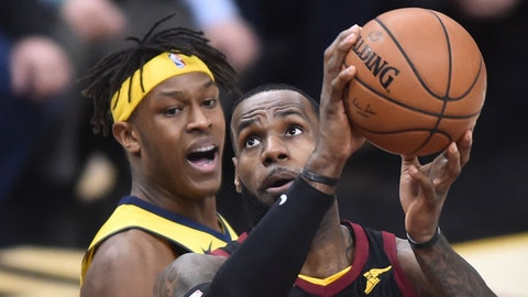 Apr 18, 2018; Cleveland, OH, USA; Cleveland Cavaliers forward LeBron James (23) drives to the basket against Indiana Pacers center Myles Turner (33) and guard Victor Oladipo (4) during the first half in game two of the first round of the 2018 NBA Playoffs at Quicken Loans Arena. Mandatory Credit: Ken Blaze-USA TODAY Sports