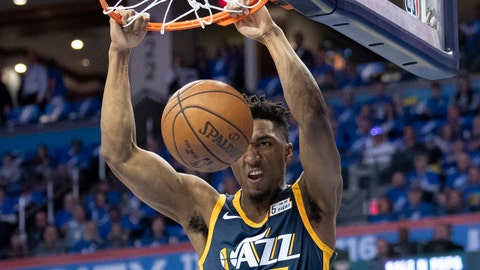 OKLAHOMA CITY, OK - APRIL 15: Donovan Mitchell #45 of the Utah Jazz dunks two points against the Oklahoma City Thunder  during the first half of  Game One of the Western Conference in the 2018 NBA Playoffs at the Chesapeake Energy Arena on April 15, 2018 in Oklahoma City, Oklahoma. NOTE TO USER: User expressly acknowledges and agrees that, by downloading and or using this photograph, User is consenting to the terms and conditions of the Getty Images License Agreement. (Photo by J Pat Carter/Getty Images) *** Local Caption *** Donovan Mitchell;