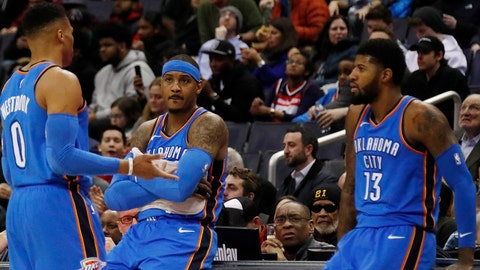 Jan 30, 2018; Washington, DC, USA; Oklahoma City Thunder guard Russell Westbrook (0) talks to Thunder forward Carmelo Anthony (7) and Thunder forward Paul George (13) against the Washington Wizards in the second quarter at Capital One Arena. The Wizards won 102-96. Mandatory Credit: Geoff Burke-USA TODAY Sports