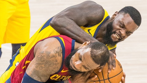 Apr 22, 2018; Indianapolis, IN, USA; Indiana Pacers guard Lance Stephenson (1) wraps up the ball for a jump ball over Cleveland Cavaliers forward LeBron James (23) in the second half of game four in the first round of the 2018 NBA Playoffs at Bankers Life Fieldhouse. Mandatory Credit: Trevor Ruszkowski-USA TODAY Sports