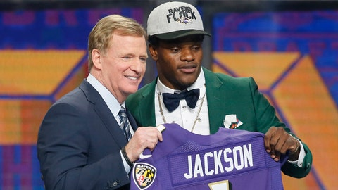 Apr 26, 2018; Arlington, TX, USA; Lamar Jackson (Louisville) with NFL commissioner Roger Goodell after being selected as the number thirty-two overall pick to the Baltimore Ravens in the first round of the 2018 NFL Draft at AT&T Stadium.  Mandatory Credit: Tim Heitman-USA TODAY Sports