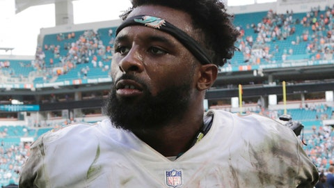FILE - In this Oct. 22, 2017, file photo, Miami Dolphins wide receiver Jarvis Landry leaves the field after an NFL football game against the New York Jets, in Miami Gardens, Fla. A person familiar with the situation says Miami Dolphins receiver Jarvis Landry has signed his $16 million, one-year franchise tag, easing the path to a potential trade. The person confirmed the signing to The Associated Press on condition of anonymity Thursday, March 8, 2018,  because the Dolphins hadn't announced the move.(AP Photo/Lynne Sladky)