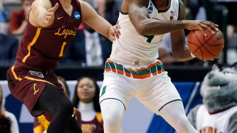 Loyola-Chicago guard Lucas Williamson, left, defends as Miami guard Lonnie Walker IV, right, prepares to make a pass in the first half of a first-round game at the NCAA college basketball tournament in Dallas, Thursday, March 15, 2018. (AP Photo/Tony Gutierrez)