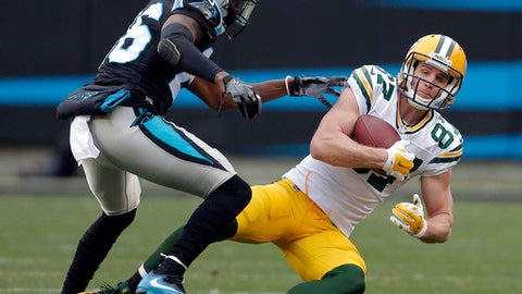 FILE - In this Dec. 17, 2017, file photo, Green Bay Packers' Jordy Nelson (87) catches a pass in front of Carolina Panthers' Daryl Worley (26) during the second half of an NFL football game in Charlotte, N.C. The Oakland Raiders are shuffling wide receivers, signing free agent Nelson and releasing Michael Crabtree. A person familiar with the moves says Nelson has agreed to a two-year contract on Thursday, March 15, 2018, after spending more than a day meeting with the former Packers star. (AP Photo/Bob Leverone, File)