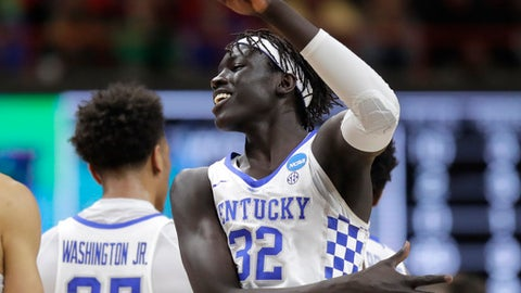Kentucky forward Wenyen Gabriel (32) celebrates a play late in the second half of a second-round game against Buffalo in the NCAA men's college basketball tournament Saturday, March 17, 2018, in Boise, Idaho. (AP Photo/Ted S. Warren)