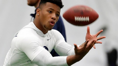 Running back Saquon Barkley (26) catches a football during Penn State NFL football Pro Day in State College, Pa., Tuesday, March 20, 2018. (AP Photo/Gene J. Puskar)