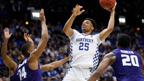 Kentucky forward PJ Washington (25) shoots against Kansas State's Levi Stockard III (34) and Xavier Sneed (20) during the second half of a regional semifinal NCAA college basketball tournament game, Thursday, March 22, 2018, in Atlanta. (AP Photo/David Goldman)