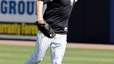 FILE - In this Feb. 19, 2018, file photo, New York Yankees' Jacoby Ellsbury works on a drill at spring training baseball camp in Tampa, Fla. Ellsbury will start the regular season on the disabled list because of an oblique injury that sidelined him three weeks. Ellsbury, who resumed playing Thursday, will remain at the Yankees' spring training complex when the team leaves Florida on Sunday for its final spring training game Monday at Atlanta. (AP Photo/Lynne Sladky, File)