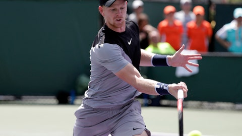 Kyle Edmund, of Great Britain, returns to Frances Tiafoe during the Miami Open tennis tournament, Saturday, March 24, 2018, in Key Biscayne, Fla. (AP Photo/Lynne Sladky)