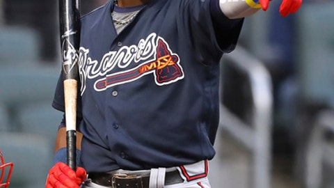 Atlanta Braves prospect Ronald Acuna Jr. points to the first base umpire for the call and was called out on strikes during the first inning against the Atlanta Braves in a baseball exhibition game Tuesday, March 27, 2018, in Atlanta. (Curtis Compton/Atlanta Journal-Constitution via AP)