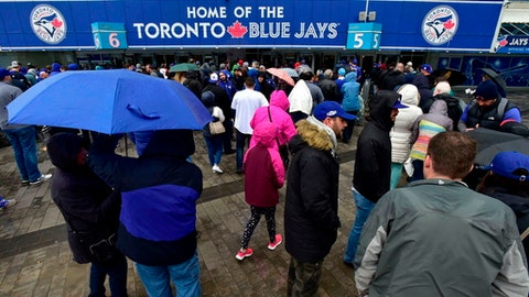 Fans arrive at the Rogers Centre for the Toronto Blue Jays opening day baseball game against the New York Yankees, Thursday, March 29, 2018, in Toronto. (Fran Gunn/The Canadian Press via AP)