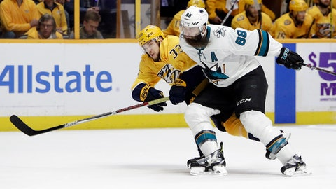 San Jose Sharks defenseman Brent Burns (88) takes down Nashville Predators left wing Viktor Arvidsson (33), of Sweden, in the second period of an NHL hockey game Thursday, March 29, 2018, in Nashville, Tenn. Burns was called for interference on the play. (AP Photo/Mark Humphrey)
