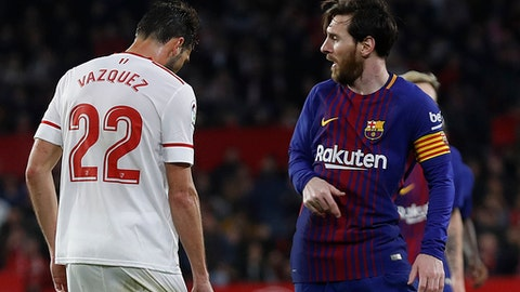 Barcelona's Messi, right, celebrates after scoring against Sevilla during La Liga soccer match between Barcelona and Sevilla at the Sanchez Pizjuan stadium, in Seville, Spain on Saturday, March 31, 2018. (AP Photo/Miguel Morenatti)