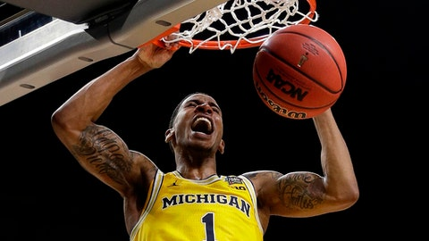 Michigan's Charles Matthews (1) dunks during the second half in the semifinals of the Final Four NCAA college basketball tournament against Loyola-Chicago, Saturday, March 31, 2018, in San Antonio. (AP Photo/David J. Phillip)