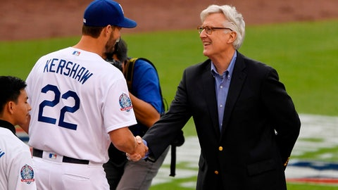 Los Angeles Dodgers' Clayton Kershaw (22) shakes hands with co-owner Mark Walter as he receives his National League Championship ring during a ceremony prior a baseball game against the San Francisco Giants Saturday, March 31, 2018, in Los Angeles. (AP Photo/Mark J. Terrill)