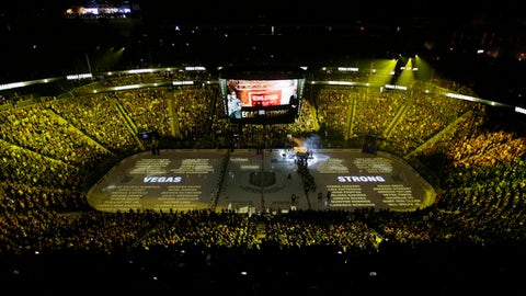 The names of people killed during the mass shooting in Las Vegas last year are projected on the ice during a ceremony before an NHL hockey game between the Vegas Golden Knights and the San Jose Sharks, Saturday, March 31, 2018, in Las Vegas. (AP Photo/John Locher)