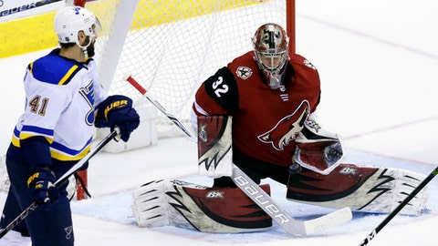 Arizona Coyotes goaltender Antti Raanta (32) makes the save in front of St. Louis Blues defenseman Robert Bortuzzo in the third period during an NHL hockey game, Saturday, March 31, 2018, in Glendale, Ariz. (AP Photo/Rick Scuteri)
