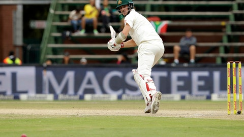 Australia's batsman Pat Cummins watches his shot on day three of the fourth cricket test match between South Africa and Australia at the Wanderers stadium in Johannesburg, South Africa, Sunday, April 1, 2018. (AP Photo/Themba Hadebe)