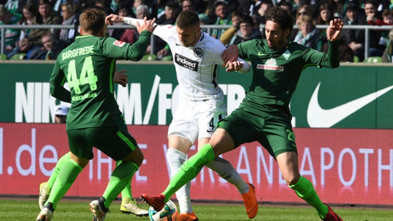 Bremen beats Frankfurt 2-1 to leave relegation fears behind