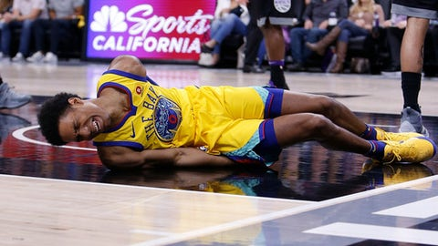 SACRAMENTO, CA - MARCH 31: Patrick McCaw #0 of the Golden State Warriors lands heavily after being fouled by Vince Carter #15 of the Sacramento Kings at Golden 1 Center on March 31, 2018 in Sacramento, California. McCaw was stretchered from the court after the incident. (Photo by Lachlan Cunningham/Getty Images)