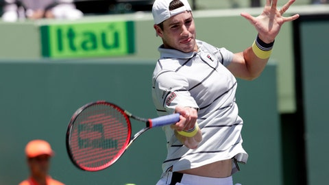 John Isner returns to Alexander Zverev, of Russia, during the final at the Miami Open tennis tournament, Sunday, April 1, 2018, in Key Biscayne, Fla. (AP Photo/Lynne Sladky)