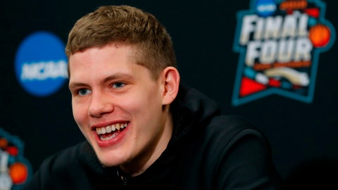 Michigan's Moritz Wagner answers questions during a news conference for the championship game of the Final Four NCAA college basketball tournament, Sunday, April 1, 2018, in San Antonio. (AP Photo/Charlie Neibergall)