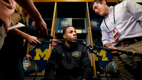 Michigan's Jaaron Simmons answers questions during a news conference for the championship game of the Final Four NCAA college basketball tournament, Sunday, April 1, 2018, in San Antonio. (AP Photo/Charlie Neibergall)