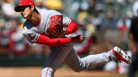 Los Angeles Angels' Shohei Ohtani works against the Oakland Athletics during the second inning of a baseball game Sunday, April 1, 2018, in Oakland, Calif. (AP Photo/Ben Margot)