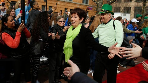Notre Dame coach Muffet McGraw and her husband, Matt McGraw, arrive for the team's championship game against Mississippi State in the Final Four of the NCAA women's college basketball tournament, Sunday, April 1, 2018, in Columbus, Ohio. (AP Photo/Ron Schwane)