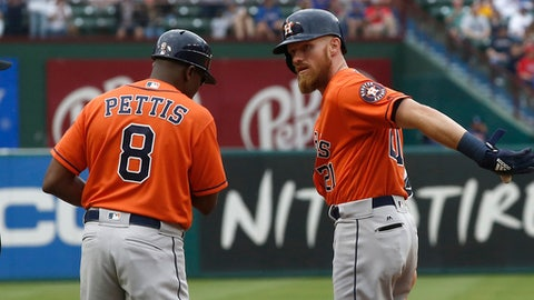 Houston Astros' Derek Fisher (21) celebrates with third base coach Gary Pettis (8) after hitting a triple and driving in a run against the Texas Rangers during the fifth inning of a baseball game Sunday, April 1, 2018, in Arlington, Texas. (AP Photo/Mike Stone)