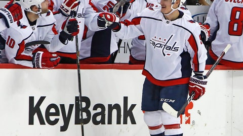 Washington Capitals' Dmitry Orlov (9) returns to the bench after scoring during the second period of the team's NHL hockey game against the Pittsburgh Penguins in Pittsburgh, Sunday, April 1, 2018. (AP Photo/Gene J. Puskar)