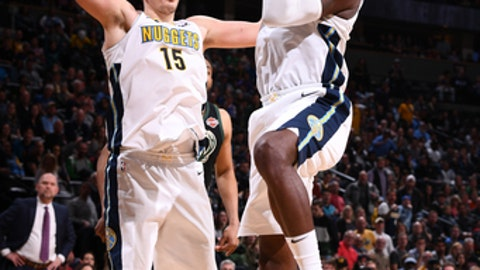 DENVER, CO - APRIL 1: Paul Millsap #4 of the Denver Nuggets gets the rebound against the Milwaukee Bucks  on April 1, 2018 at the Pepsi Center in Denver, Colorado. (Photo by Garrett Ellwood/NBAE via Getty Images)
