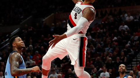 PORTLAND, OR - APRIL 01:  Damian Lillard #0 of the Portland Trail Blazers dunks against the Memphis Grizzlies at Moda Center on April 1, 2018 in Portland, Oregon.(Photo by Jonathan Ferrey/Getty Images)