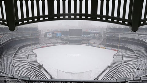 Snow covers the field before a scheduled New York Yankees' home opener game against the Tampa Bay Rays at Yankee Stadium Monday, April 2, 2018 in New York. The game was postponed due to weather and rescheduled for Tuesday. (AP Photo/Seth Wenig)