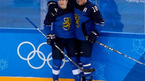 FILE - In this Feb. 16, 2018, file photo, Eeli Tolvanen, of Finland, left, celebrates a goal with Sami Lepisto (18) during the second period of the preliminary round of the men's hockey game against Norway at the 2018 Winter Olympics in Gangneung, South Korea.  The Nashville Predators have signed forward Eeli Tolvanen of Finland, the 30th pick overall last year, to an entry-level contract, adding the talented 18-year-old to a roster already sitting atop the NHL. General manager David Poile announced Thursday, March 29, 2018, that the immigration and other paperwork had been completed with Tolvanen agent Jay Grossman in Nashville to finalize the last details.  (AP Photo/Frank Franklin II, File)