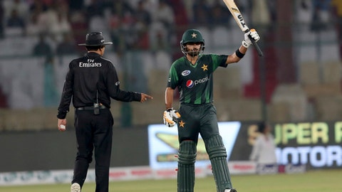 Pakistani batsman Hussain Talat acknowledges his fifty against West Indies in Karachi, Pakistan, Monday, April 2, 2018. Pakistan has won the toss and elected to bat in the second Twenty20 against the West Indies. West Indies trails the three-match series 1-0 after being crushed by 143 runs on Sunday. (AP Photo/Shakil Adil)