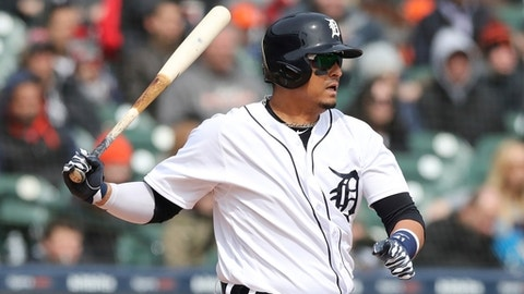 Detroit Tigers designated hitter Victor Martinez hits a two-run single during the fifth inning of a baseball game against the Kansas City Royals, Monday, April 2, 2018, in Detroit. (AP Photo/Carlos Osorio)