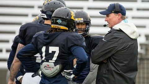 "<p>(STATS) - ETSU coach Randy Sanders was placed on paid administrative leave Monday, reportedly for hitting a player in the helmet during practice.</p><p>The Southern Conference school said in a one-sentence statement it is investigating a ""potential violation of university policy."" The Johnson City Press reported two sources said Sanders hit freshman defensive back Tyree Robison in the helmet when the player failed to take a knee during a drill on Friday.</p><p>Sanders, 52, was hired Dec. 17 to replace Carl Torbush, who retired three years after resurrecting an ETSU program that disbanded following the 2003 season.</p><p>Sanders was Florida State's offensive coordinator on Jimbo Fisher's staff last season. A college assistant for 28 years, he has coached on two national championship-winning staffs - Tennessee in 1998 and Florida State in 2013. The Tennessee graduate also was an assistant at Kentucky.</p><p>No timetable was set for Sanders' potential return. He will not coach in ETSU's spring game Thursday night.</p>"